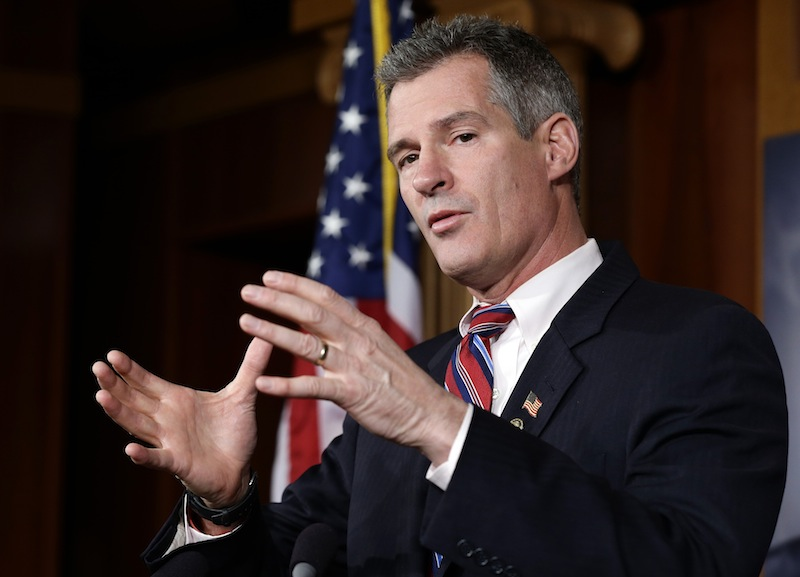 In this Nov. 13, 2012 file photo, then-U.S. Sen. Scott Brown, R-Mass., speaks during a media availability session. Brown announced Monday he had landed a new job with an international law firm but did not rule out a future run for political office in Massachusetts. (AP Photo/Alex Brandon)