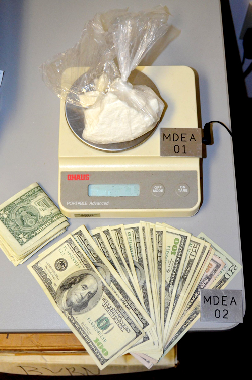 Police say they seized crack cocaine with a street value of about $16,000 and $1,954 in cash from the car driven by Nega Negash.