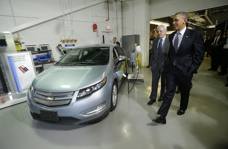 President Barack Obama and Joint Center for Energy Storage Research Director Dr. George Crabtree walk past a hybrid Chevy Volt vehicle used for testing during the president's tour of the Argonne National Laboratory in Argonne, Ill., Friday, March 15, 2013. Argonne is the first US science and engineering research national laboratory, and it remains on of the nation's largest. (AP Photo/Pablo Martinez Monsivais)