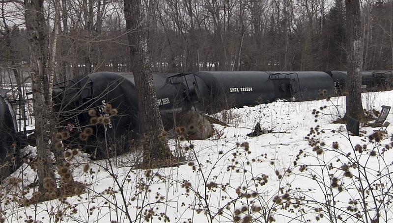 This March 7 photo, provided by WABI-TV5 in Bangor, shows derailed tank cars in Mattawamkeag. Fifteen cars of a 96-car train carrying crude oil went off the tracks at about 5 a.m., about 60 miles north of Bangor.