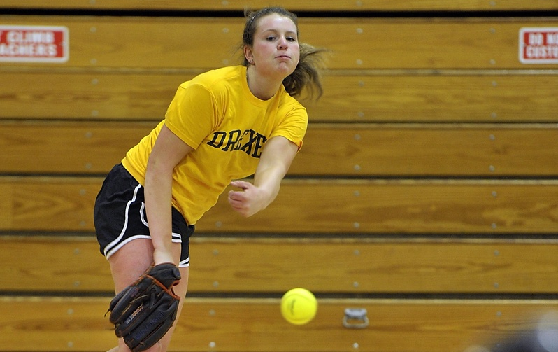 Alyssa Williamson, a junior, fires one of many pitches on the first official day of softball practice at Scarborough High School.