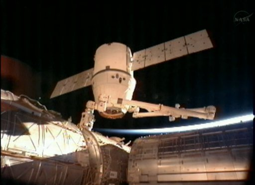 This image provided by NASA-TV shows the SpaceX Dragon commercial cargo craft after it was detached from the International Space Station early Tuesday by the International Space Station's Canadarm2 robotic arm. The Dragon is expected to splash down in the eastern Pacific ocean approximately 246 miles off the coast of Baja Calif., later today.