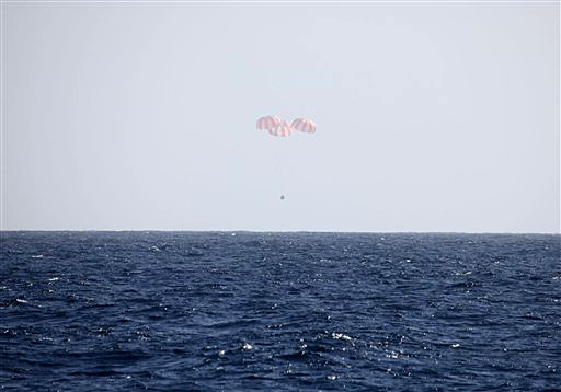 In this image provided by SpaceX, the Dragon capsule uses parachutes to descend to the Pacific Ocean off the coast of Mexico's Baja Peninsula on Tuesday.