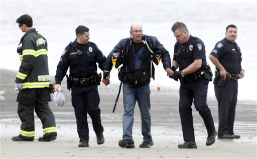 One of three people rescued from a stolen yacht is arrested by police in Pacifica, Calif. The boat was stolen from Sausalito, Calif.