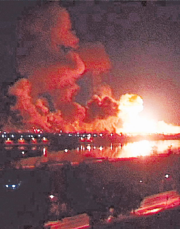 Fire erupts after a missile impacts a government building during heavy bombardments in Baghdad on March 21, 2003.