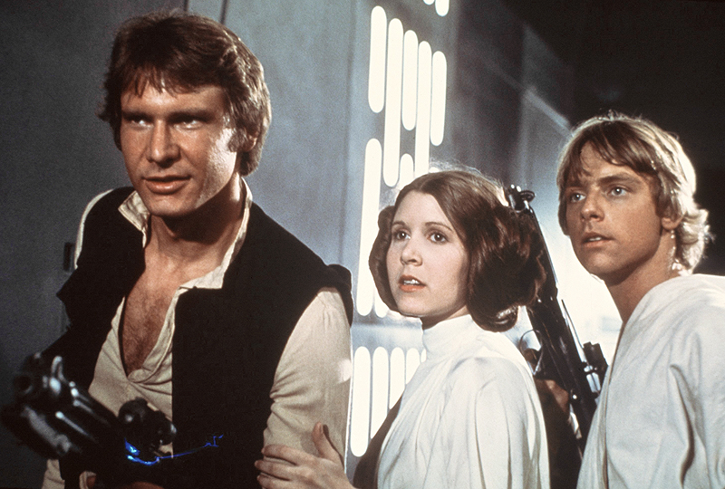 "In a theater long ago ..... above, from left, Harrison Ford, Carrie Fisher, and Mark Hamill in ""Star Wars"" in 1977."