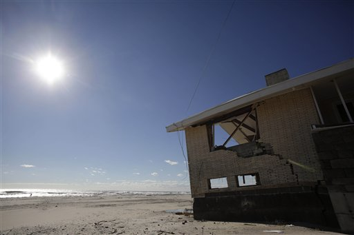 A storm-damaged beachfront house is shown in the Far Rockaways section of the New York City borough of Queens in January. Homeowners shaken by their Superstorm Sandy experience are putting their homes on the market, sometimes for rock-bottom prices. hurricane