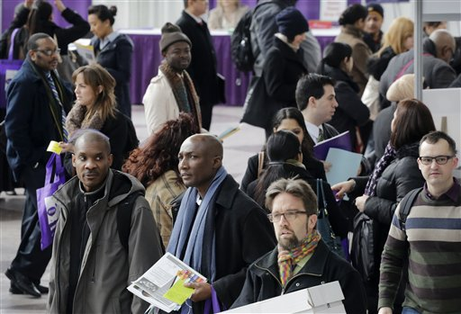 Job seekers attend a health care job fair on Thursday in New York. Fewer layoffs are strengthening the job market.