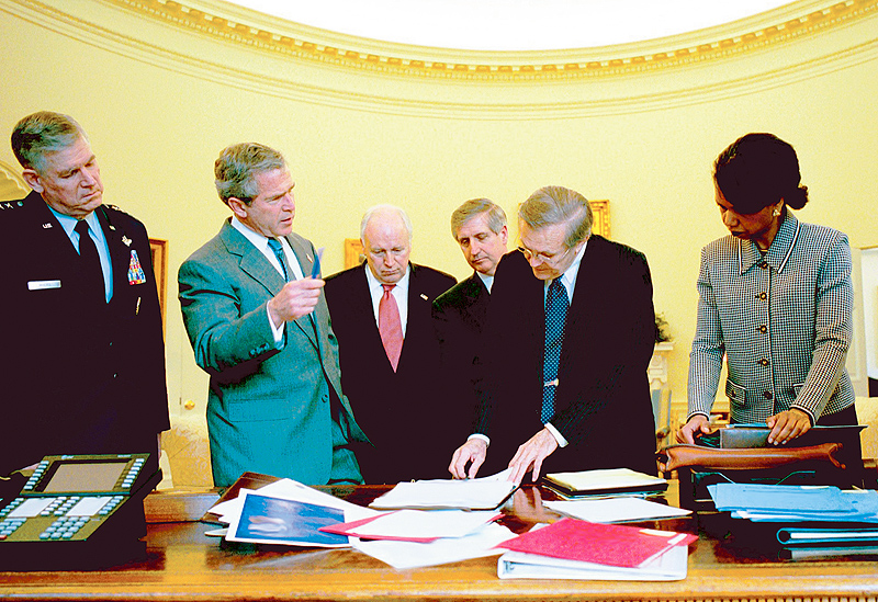 President Bush reviews the progress of the war with members of the War Council on April 2, 2003.