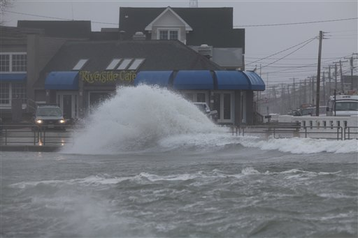 Wind, rain and the tide batter the Jersey Shore as a winter storm moves at the Point Pleasant inlet in Manasquan, N.J.