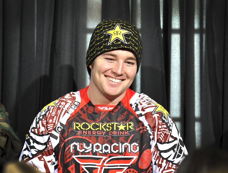 In this photo taken Jan. 25, 2012 and released by ESPN Images, snomobiler Caleb Moore smiles while attending a news conference at the Winter X Games in Aspen, Colo. Moore died on Tuesday, Jan. 31, 2013, in a Colorado hospital after a dramatic crash at the Winter X Games in Aspen. (AP Photo/ESPN Images, Eric Lars Bakke) 2012; Winter X Games; Caleb Moore