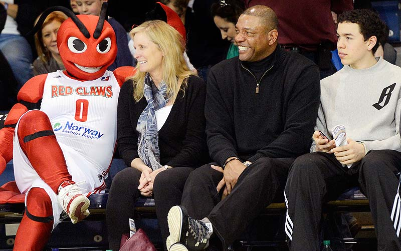 Red Claws mascot Crusher finds an open seat during Sunday's game next to the Rivers clan – Doc, center, with his wife, Kristen, and their youngest son, Spencer.