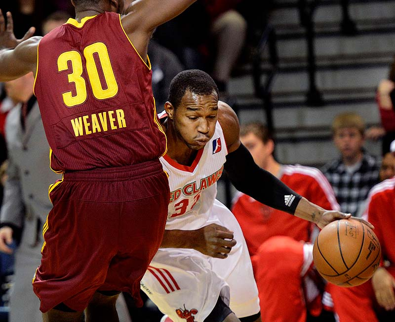 Maine's Chris Wright drives around Kyle Weaver of the Canton Charge Sunday at the Porland Expo. The Claws lost, 108-83.