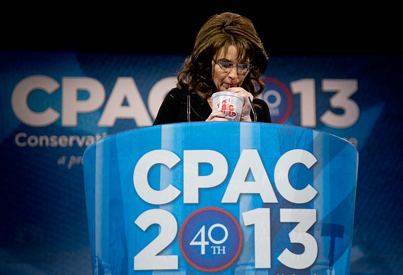 Former Alaska Gov. Sarah Palin drinks from a 7-Eleven Super Big Gulp on stage while speaking at the 40th annual Conservative Political Action Conference in National Harbor, Md., on Saturday.