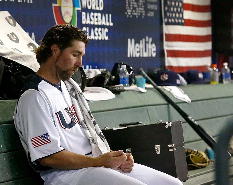 United States' R.A. Dickey sits in the dugout in the fourth inning during a World Baseball Classic baseball game against Mexico on Friday in Phoenix. Mexico defeated the United States 5-2.