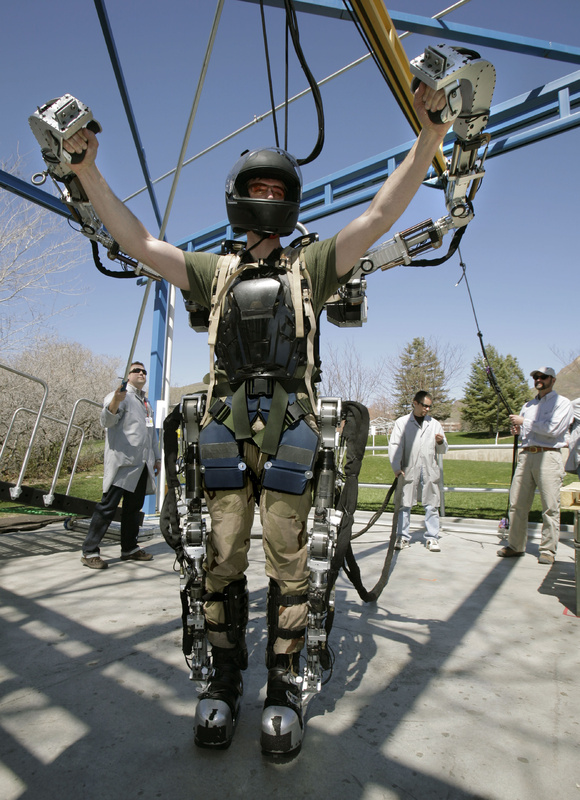 "A Raytheon software engineer stretches in a robotic suit made for the Army in Salt Lake City in 2008. A reader says median salaries for software engineering and information technology jobs in Maine ""tend to fall significantly behind national median salaries"" for the same type of work."