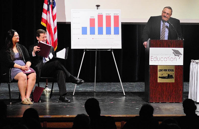 Michelle Zhang, a Cony High School senior, and Stephen Bowen, commissioner of education, listen as Gov. Paul LePage opens the Governor's Conference on Education: Putting Students First on Friday at Cony High School in Augusta.