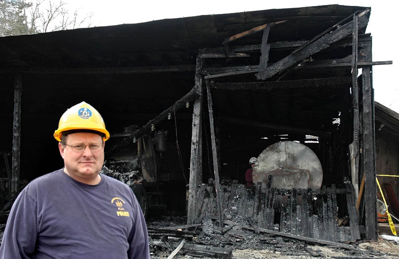 Sgt. Joel Davis of the State Fire Marshal's Office helped investigate the arson fires in Bingham over the weekend. Behind him is the public works garage.
