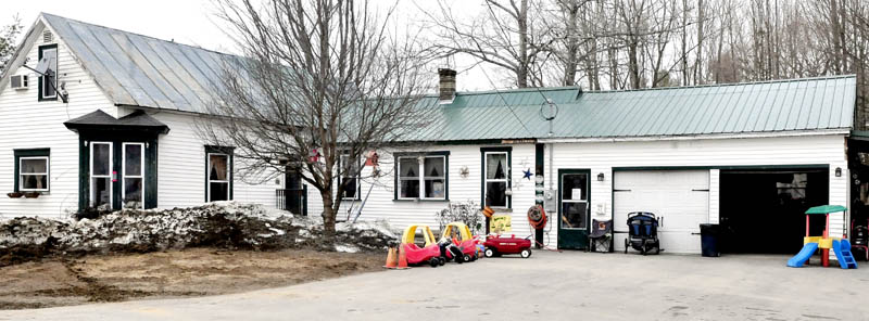 Children's toys can be seen outside the ABC 123 Daycare on Upper Main Street in Norridgewock on Monday, March 11, 2013. The state has shut down the center after the owner's husband was charged with unlawful sexual contact with three children earlier this month.