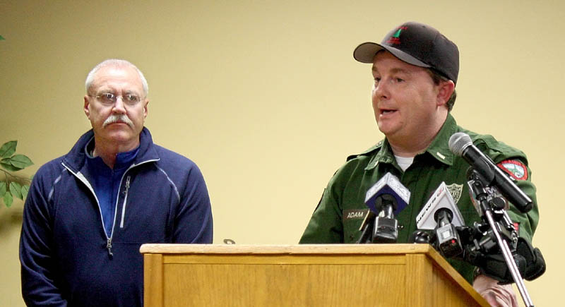 Maine Warden Service Lt. Kevin Adams, right, answers questions about the search for Nicholas Joy, of Medford, Mass., during a press conference Monday in Carrabassett Valley. At left is Richard Wilkinson, vice president of mountain operations at Sugarloaf, where the 17-year-old was last seen Sunday.