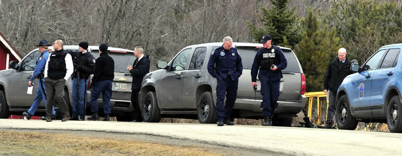 Maine State Police troopers and detectives converged at a residence on Barker Road in Troy on Wednesday. Police said a man shot himself at his home as he was about to be arrested for child sexual charges.