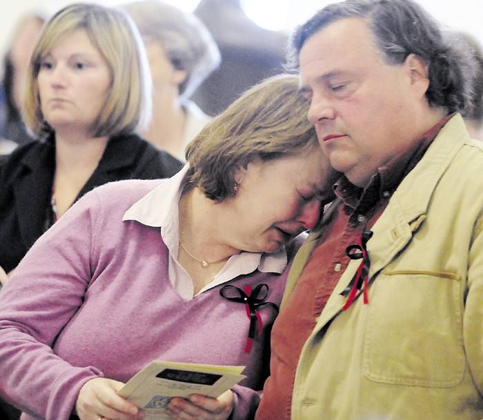 Donna Mills and her husband, Tim Mills, comfort each other during a poem reading in September 2010, at the State of Maine 3rd Annual Day of Remembrance For Murder Victims ceremony held in the State House Hall of Flags in Augusta. Tim Mills on Monday, March 4, 2013 testified in favor of LD 573, which would prevent murderers and class A felons from voting while incarcerated.