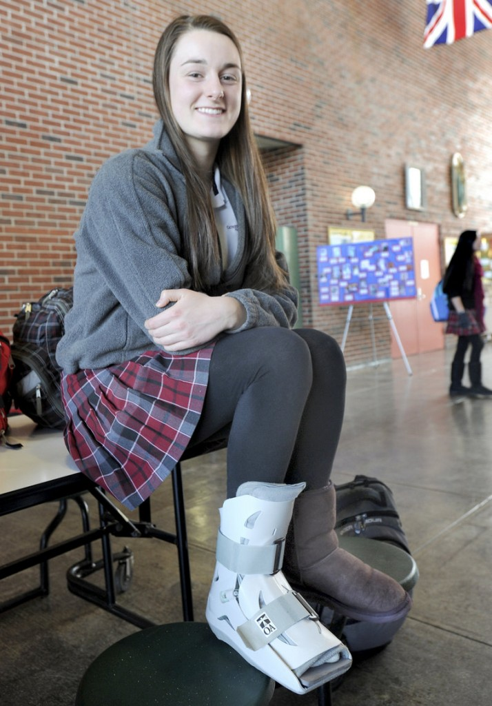 Allie Clement of McAuley knows her right foot isn't broken, but is waiting until the season ends for an MRI.