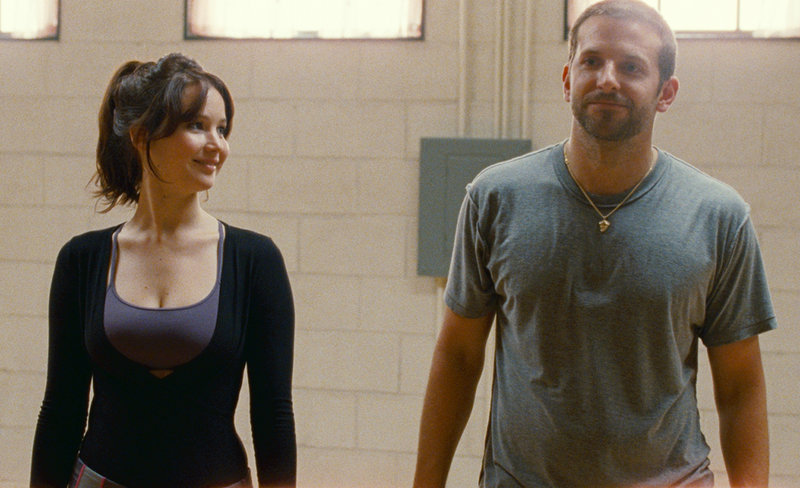 "Best Actress winner Jennifer Lawrence and Bradley Cooper in ""Silver Linings Playbook."""