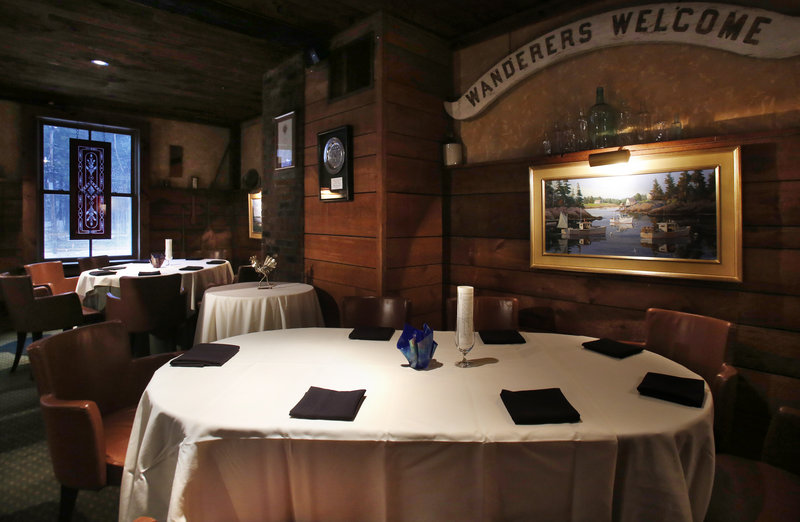 The casual dining area adjacent to the main dining room is the setting for winter bistro meals, including an unforgettable $25 hamburger, at the White Barn Inn in Kennebunk.