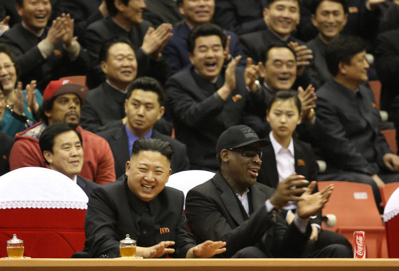 BFFs? North Korean leader Kim Jong Un, left, and former NBA star Dennis Rodman watch North Korean and U.S. players in an exhibition basketball game Thursday.
