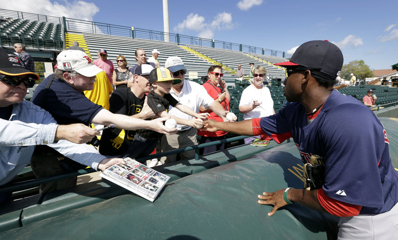 Jackie Bradley Jr., who played for the Sea Dogs last season and is with the Red Sox in spring training, signs autographs Thursday before the game against the Pittsburgh Pirates.
