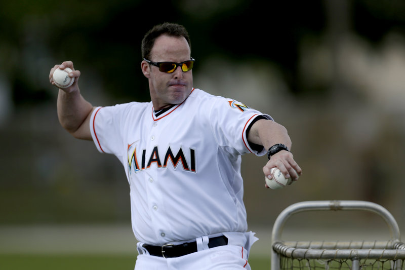 Mike Redmond, a former Sea Dogs catcher, now is the Miami Marlins' manager, leading a low-priced team that may be helped by listening to Mike Lowell, a former Marlin.
