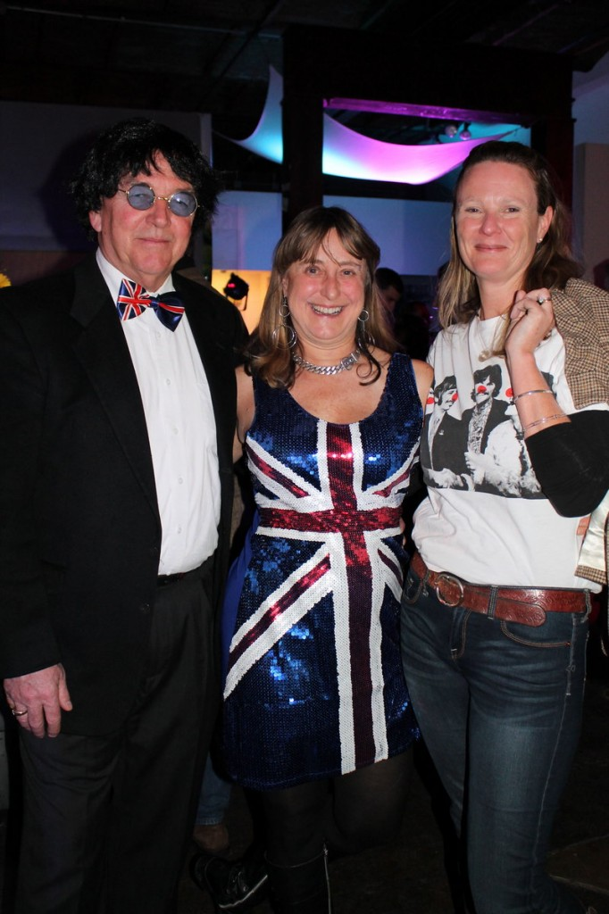 Guests Tom and Debrah Yale and Claire Depke tip their hat to The Guv'nors, a Beatles cover band that served up the evening's entertainment.