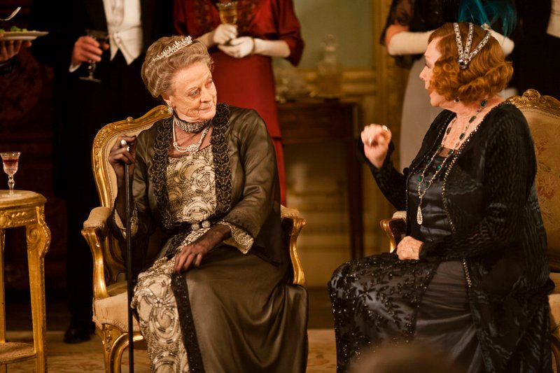 "Maggie Smith as Lady Violet Crawley, the dowager countess of Grantham, left, from ""Downton Abbey."" A self-confessed addict wonders if Americans' love for the series is due partly to the characters' ""delicacy of speech."""