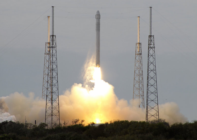 The Falcon 9 SpaceX rocket lifts off from launch complex 40 at Cape Canaveral, Fla., on Friday.
