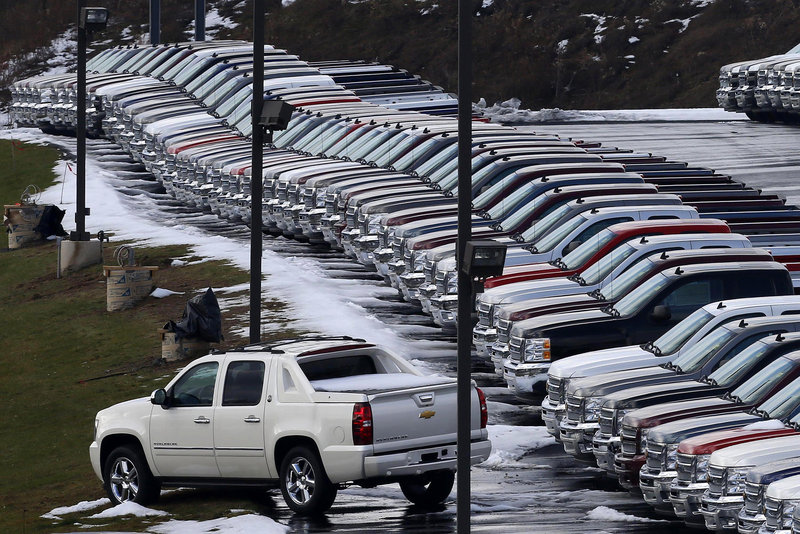 Chevy trucks line the lot of a dealer in Murrysville, Pa. General Motors said sales of its pickups to small businesses in February were up 40 percent from a year ago, partly because of growth in home building.