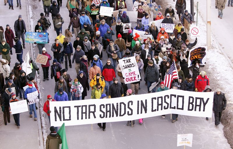 Hundreds of people march to the Maine State Pier in Portland in January to attend a rally protesting the possible use of the Portland-to-Montreal pipeline to send tar sands crude oil to Casco Bay.