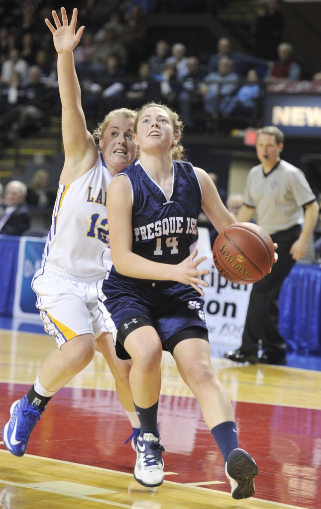 Chandler Guerrette, driving past Sarah Hancock of Lake Region, took over in the fourth quarter Friday night, scoring 14 of her 33 points in Presque Isle's 51-44 victory.
