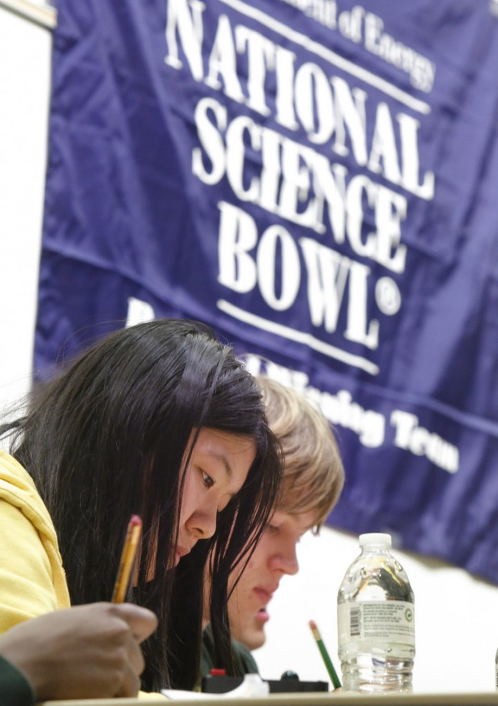 Waynflete students Sally Li and Zander Majercik work out a problem in a semifinal round at the Science Bowl at the University of Southern Maine in Gorham on Saturday.