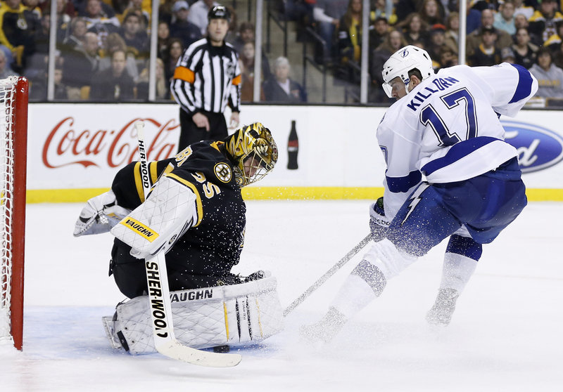 Boston goaltender Anton Khudobin drops to the ice to frustrate Alex Killorn's scoring bid during third-period action of Saturday's Bruins-Tampa Bay Lightning game in Boston, won by the Bruins 3-2.