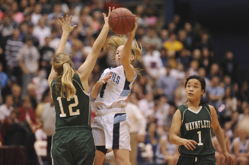 Martha Veroneau of Waynflete won't give ground, forcing Maddy McVicar of Calais into a pass during Waynflete's 59-55 victory.