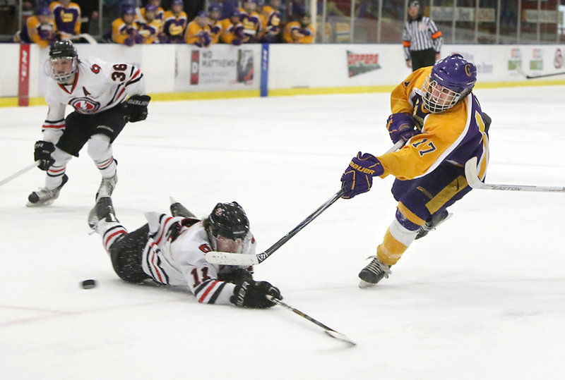James Hannigan of Cheverus fires a shot past Scarborough's Ryan Bailer to score the first goal of the game.