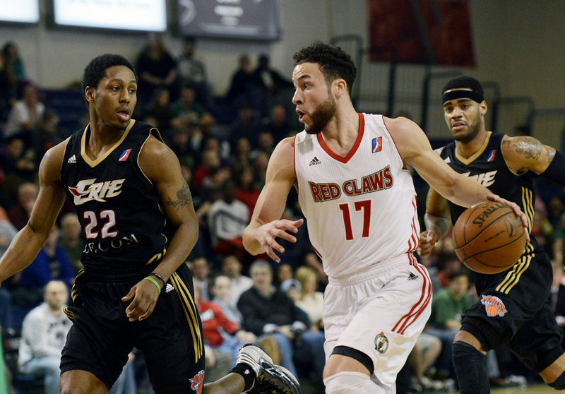 Red Claws guard Jeremiah Rivers pushes the ball up the court while chased by Erie's Demonte Harper during Sunday's D-League game at the Portland Expo. Rivers had 11 points and seven rebounds in Maine's 102-101 win.