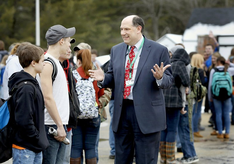 "Massabesic High School Principal Christian Elkington visits with students waiting for a bus at the end of the school day in Waterboro on Friday. ""We're being told, even if we're making gains, they're not good enough,"" Elkington said."