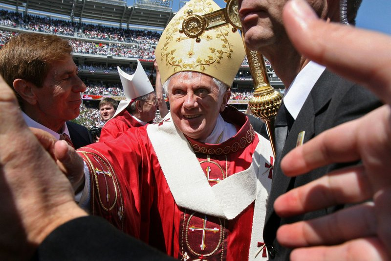 Pope Benedict XVI greets the faithful after celebrating Mass at Nationals Park in Washington in 2008. The pope announced on Feb. 11 that he would step down as head of the Catholic Church. The conclave, or voting meeting, is expected this month.