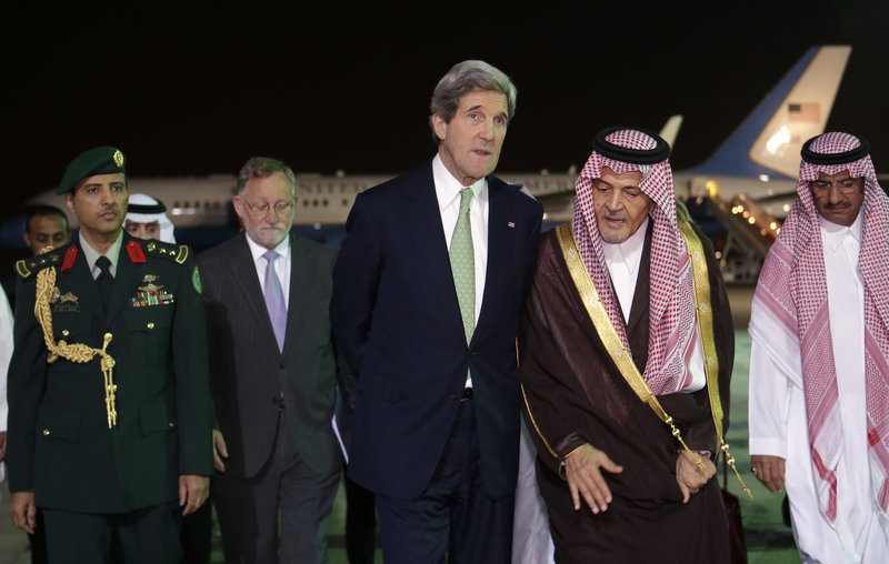 Secretary of State John Kerry walks with Saudi Foreign Minister Prince Saud al-Faisal as he arrives Sunday in Riyadh, Saudi Arabia, on the seventh leg of his first official overseas trip.