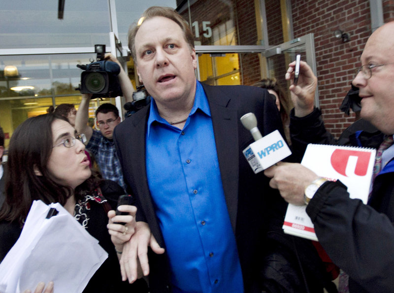 In this May 21, 2012 file photo, former Boston Red Sox pitcher Curt Schilling, center, departs the Rhode Island Economic Development Corporation headquarters in Providence, R.I. Attorneys representing Schilling and others at his former startup, 38 Studios, on Friday, March 1, 2013, filed documents asking Superior Court Judge Michael Silverstein to dismiss a state economic development agency lawsuit over its $75 million loan guarantee for his now-defunct video game company. (AP Photo/Steven Senne, File)