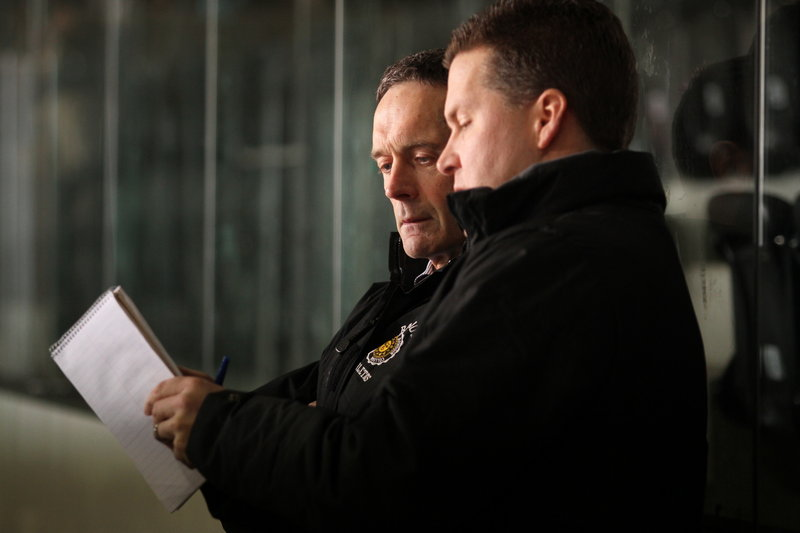 Terry Meagher, left, with assistant coach Jamie Dumont, thinks outside the box as the Bowdoin College hockey coach, and it's worked. He's approaching 500 career victories.
