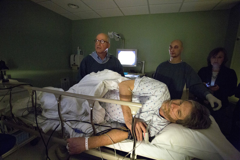 Portland Press Herald columnist Bill Nemitz underwent a colonoscopy at the Portland Gastroenterology Center on Tuesday, March 5, 2013, to bring attention to Colorectal Cancer Awareness Month. Performing the procedure, from left, is Dr. James Morse, and endoscopic technician Ben Emery.