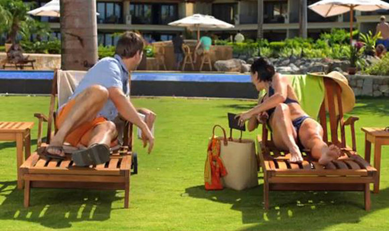 A Kindle Paperwhite commercial features a vacationing man and woman both waiting for their husbands, shown in the background at a bar. Gay people are increasingly part of screen and print advertising.